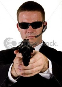 Atelier du 5 novembre 2012 stock-photo-young-man-suggesting-a-secret-service-agent-or-secret-policeman-pointing-a-gun-with-a-laser-site-at-18392647-214x300